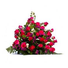 Spruzzo funebre di rose rosse